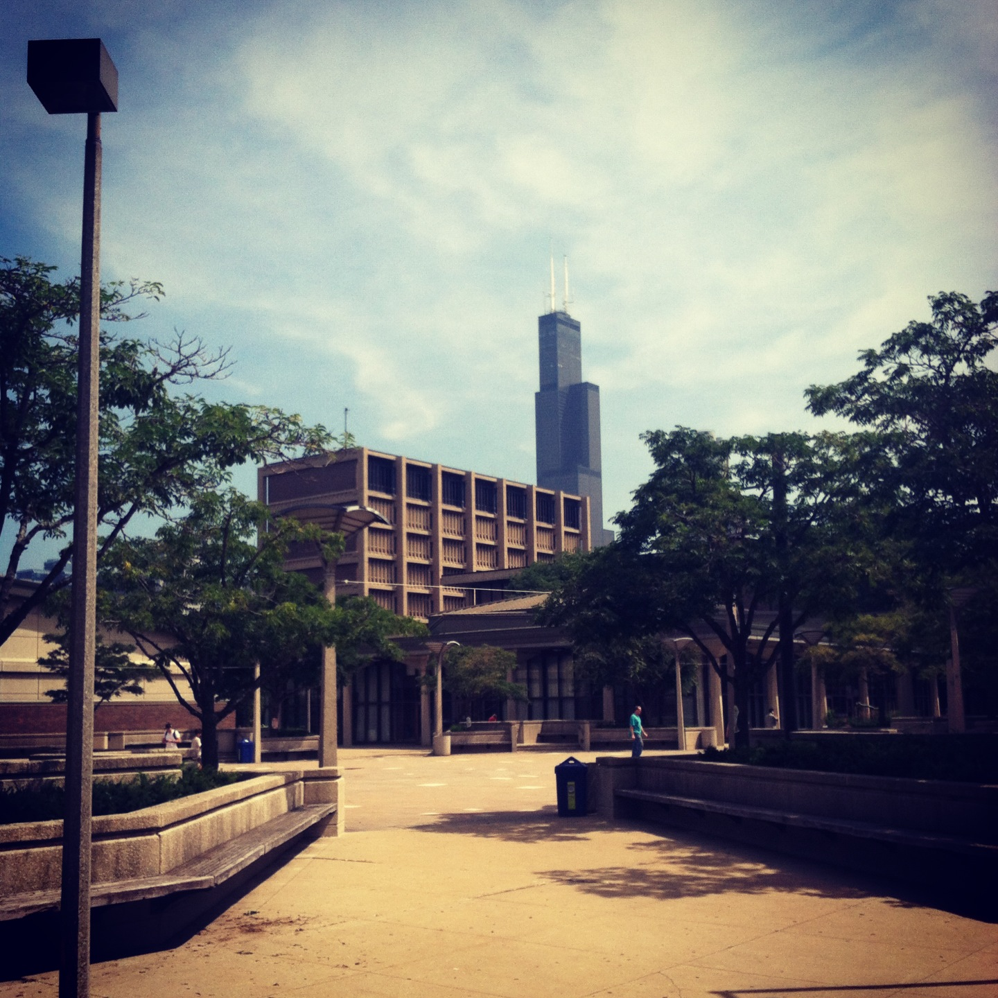 the sears tower looms beyond the brutalist campus of the university of illinois chicago, where the summer institute on sustainability and energy (SISE) takes place.